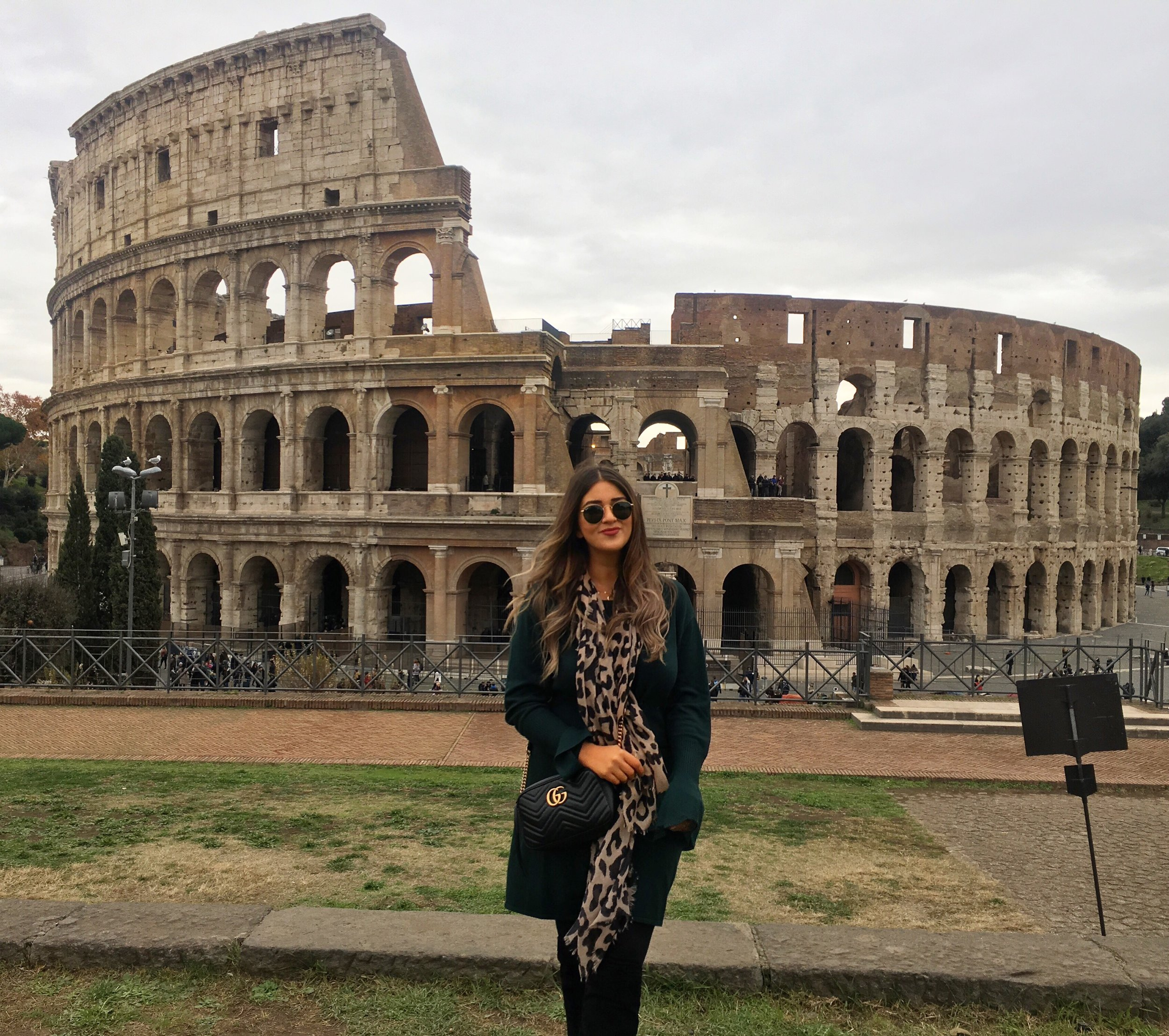 Posing in front of the Colosseum in Rome after consuming way too much pizza and wine. Worth it though!
