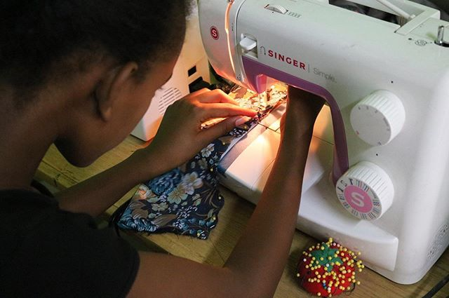 It's all in the details! Our girls work with pins to ensure straight stitches. Continue supporting their education by donating at https://www.giftsforconfidence.org/donate
