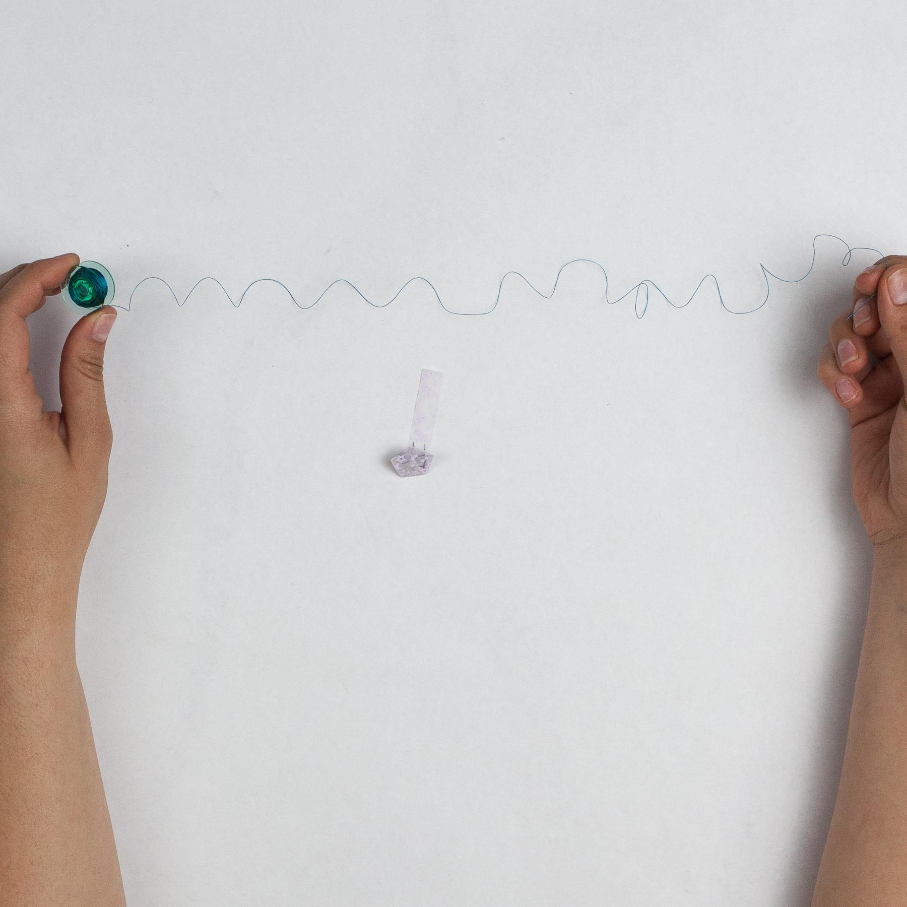 cut a long piece of thread
