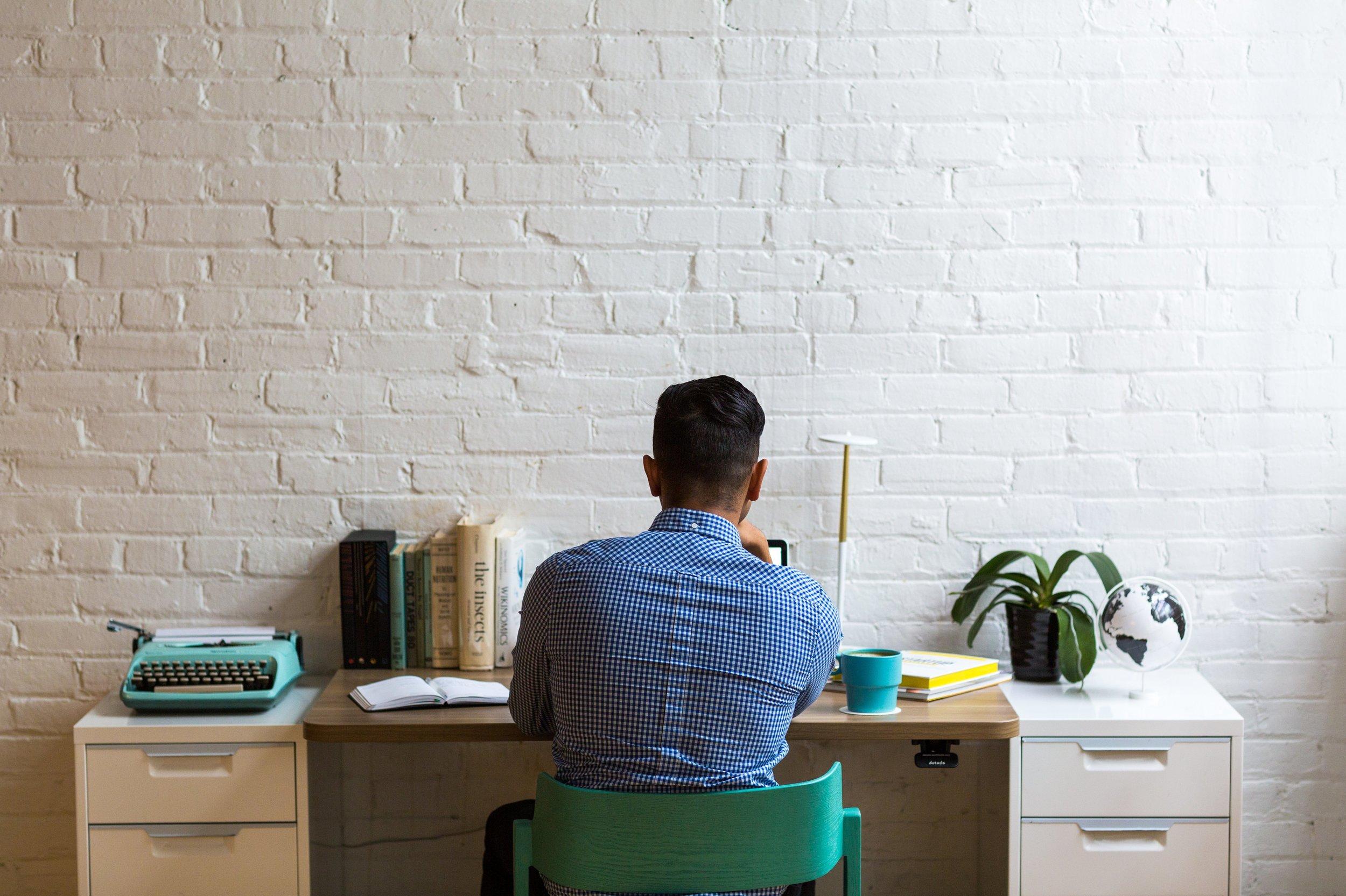man-working-in-modern-office_4460x4460.jpg