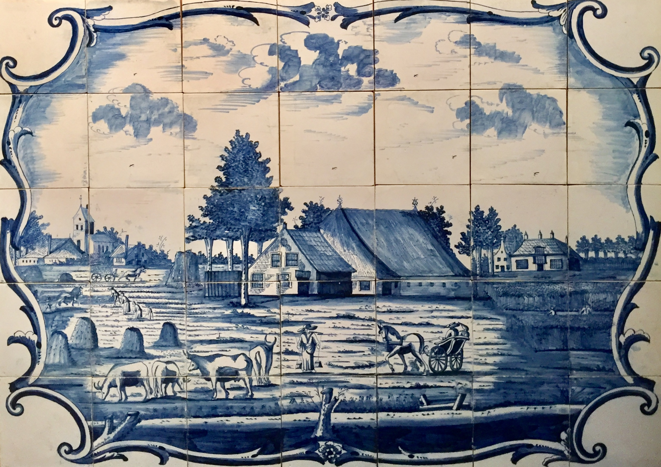 A Dutch Friesian landscape painted with cobalt like the Delft Blue ware.