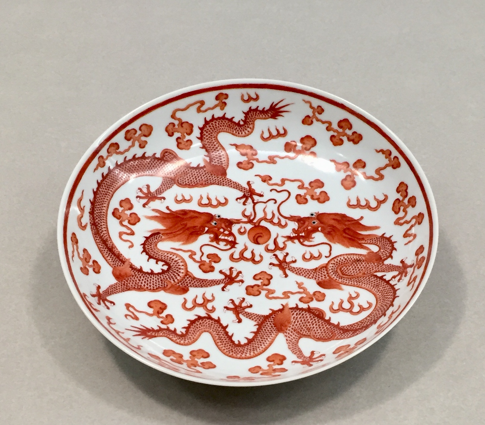 "Red dragons in ""Wucai"" polychrome enamels, Qing Dynasty 1662 - 1722."