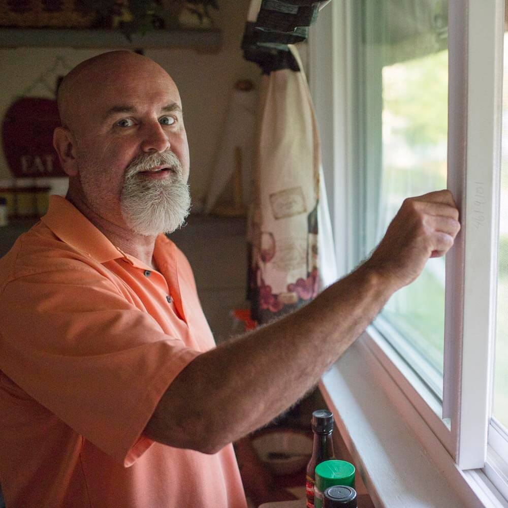 New energy-efficient windows improve Ted's heating & cooling systems.