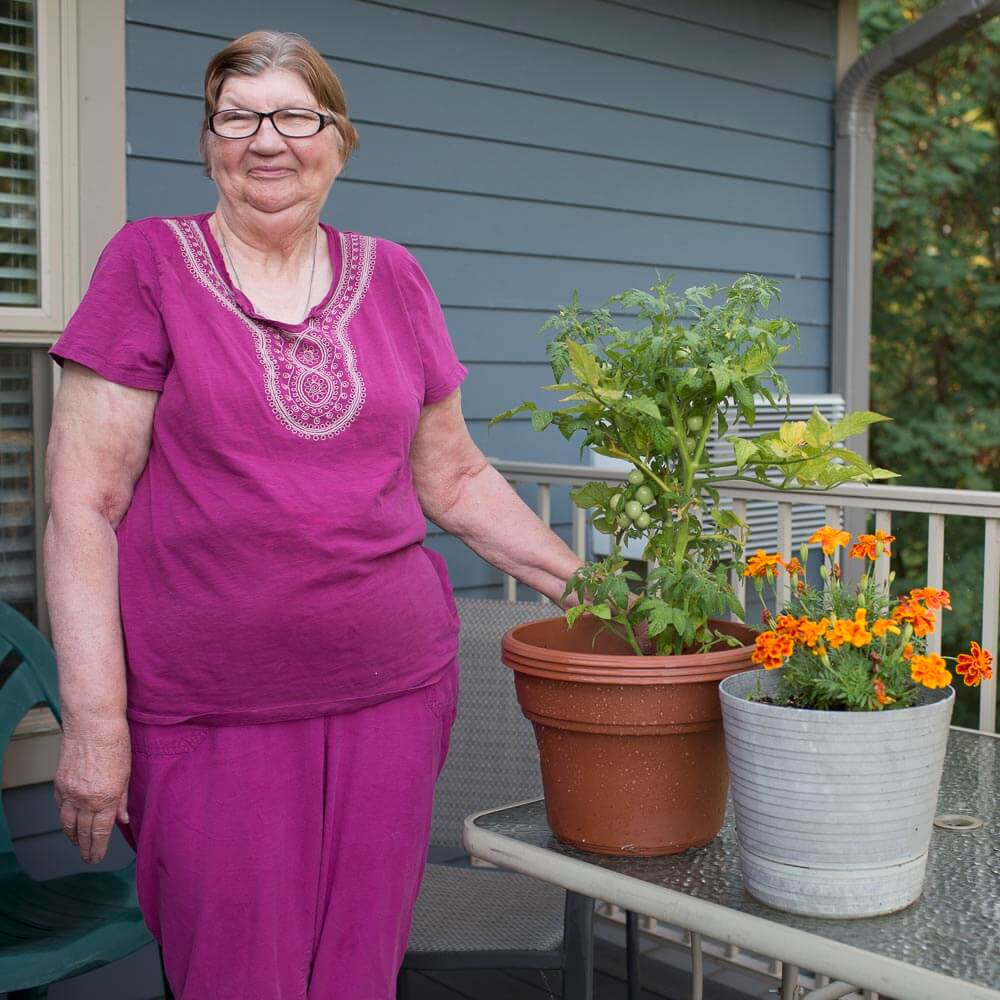 Donna shows the plants on her patio.