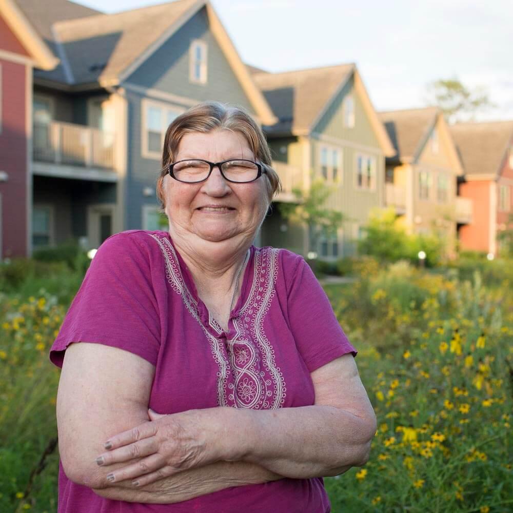 Donna enjoys the riverside gardens at Elven Sted.