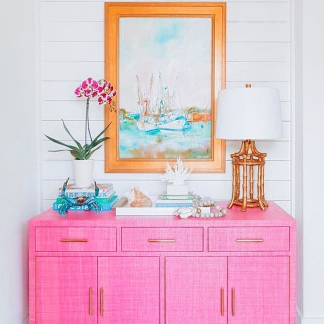 All things nautical ⚓️ + vibrant colors 💕 make for the  b e s t  decor 😍 One of my fave artists that I found through insta is @daniellecathercohenart - her use of color is *swoon* amazing. And every time I see a @societysocial piece, like this grasscloth credenza, I immediately wonder how I have made it so long without one in my life 🤯🙋♀️This is snap of @charlestonblonde home and I couldn't be more in love with the whole set up! 🥰  #interiordesign #charleston #lowcountry #coastal #decor