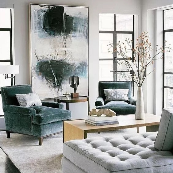 The color green is showing up in so many different shades lately. I love the look of the muted dark green in the artwork and the fabric on the chairs. It pairs easily with any neutral. 📷: Worthing Court via the spruce.com