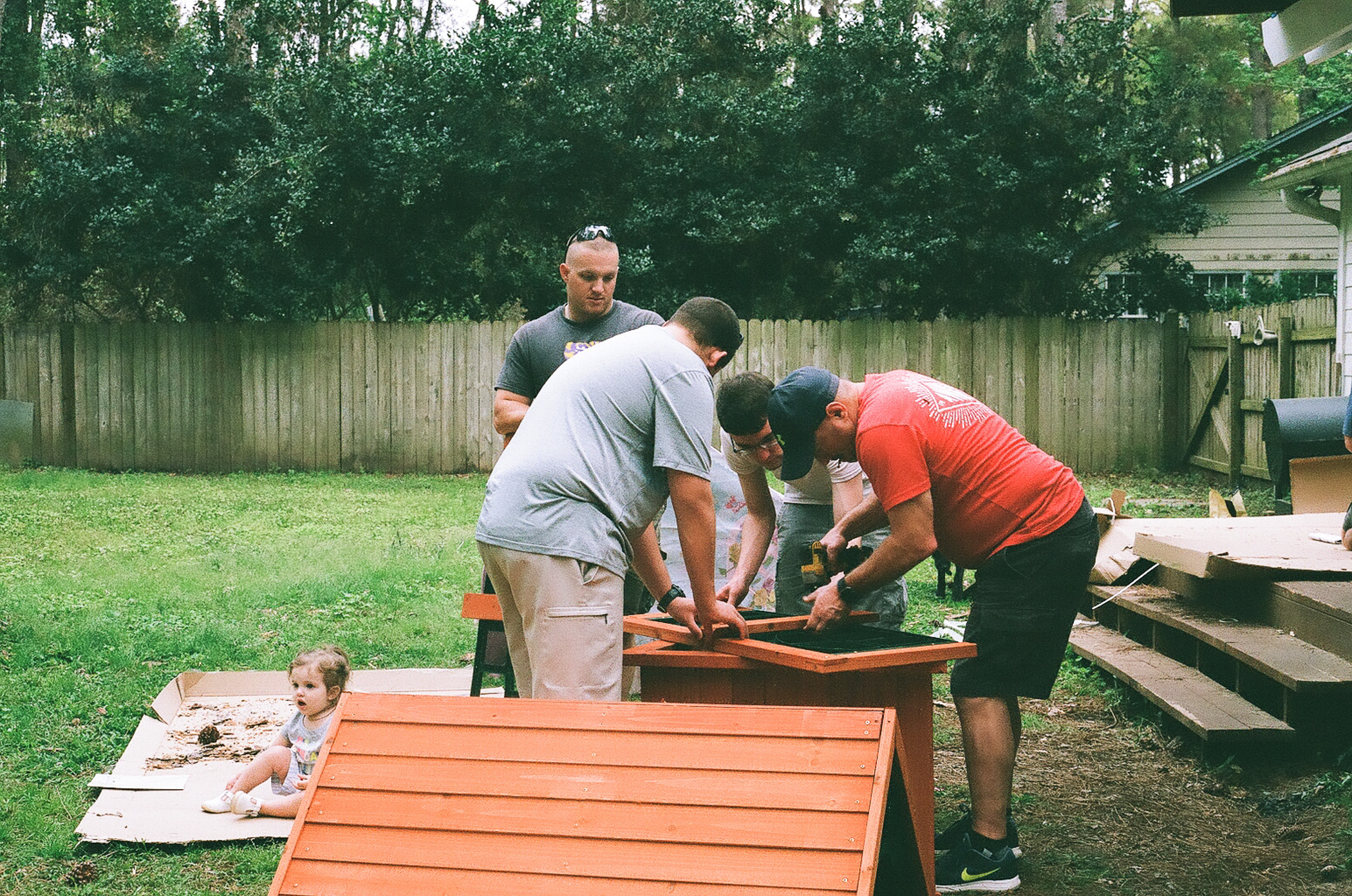 How many men does it take to build one play set?