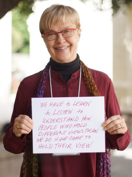 Carolyn Lukensmeyer holds up her takeaways from the conference about inclusion and diversity.