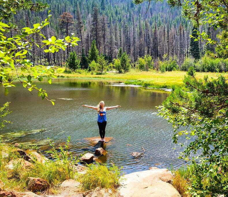 Mary Susan in Tadasana with arms out to sides, CO love tank in RMNP.jpg