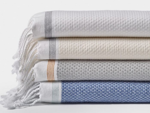 The Turkish Touch - The quick-drying workhorse towel that adds lightweight luxury to any bathing experience. Turkish Towels are made with a centuries-old Anatolian weaving technique that results in a faster-drying and higher-absorbency towel with much less bulk than traditional weaves.Snag these fringed beauties from Coyuchi, which are woven in the Aegean region of Turkey from 100% locally sourced organic cotton. This product meets the GOTS (Global Organic Textile Standard).Anna's pick: Coyuchi - Mediterranean Organic Towels, Undyed with Slate Stripe (second from top). The 6-pc Set is reasonably priced at $148.00 and comes with a 365-day guarantee. Image Source: coyuchi.com