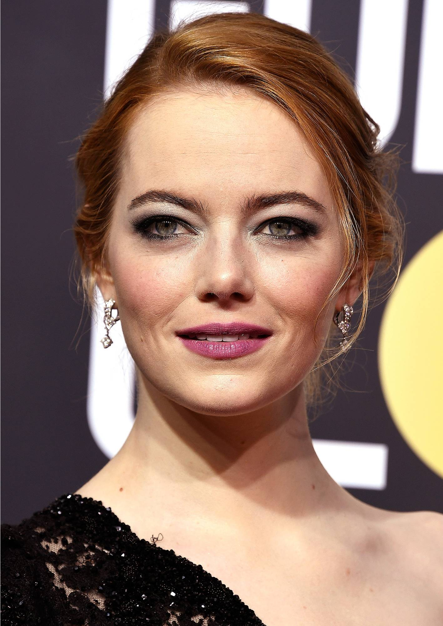 Emma Stone - I am HERE for a redhead in a purple lip! Emma's makeup artist Rachel Goodwin used a color palette inspired by the women's suffrage movement including purple, white, and green. Use this as inspiration to rock a face beat inspired by what you're passionate about! My next look will be