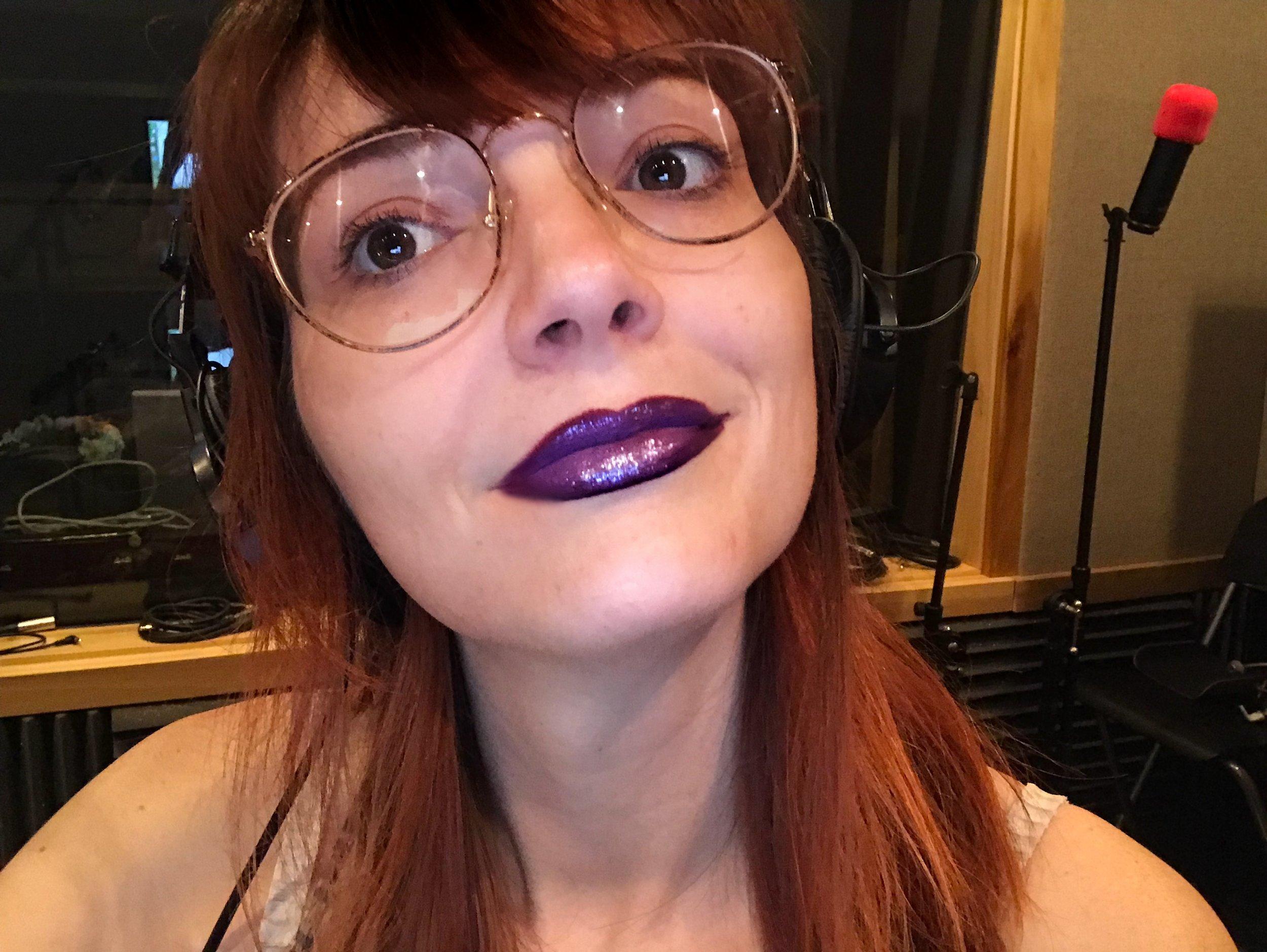 Jackie Johnson in the studio rocking a purple ombre lip.