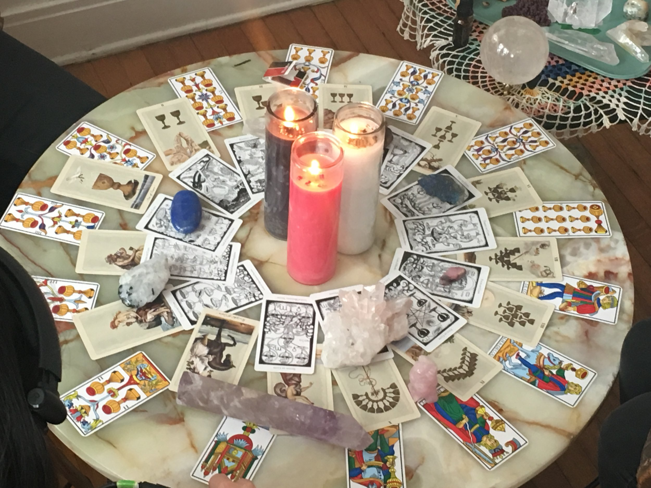 Tarot cards, crystals, and candles.