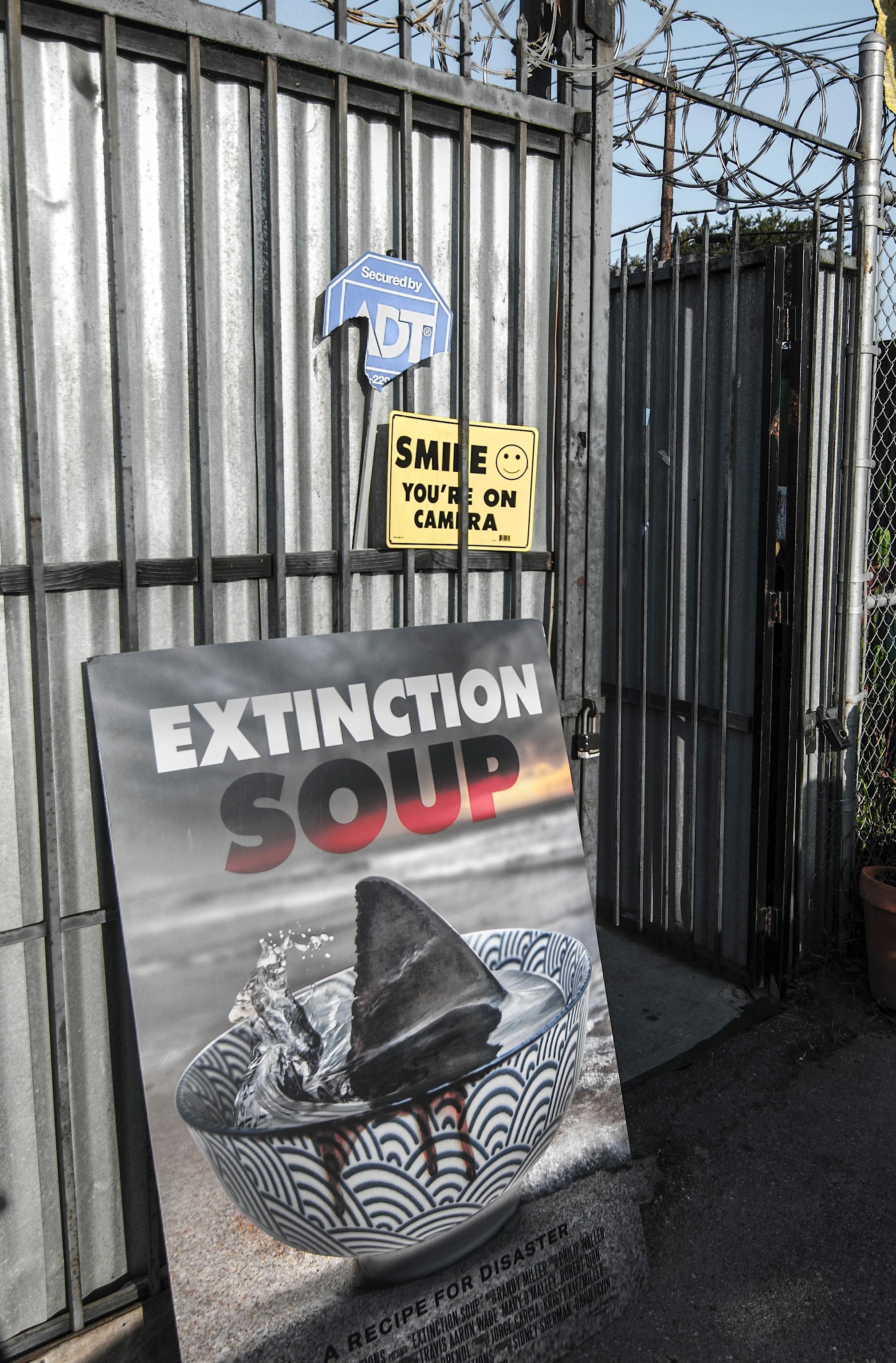 Extinction Soup fim sign