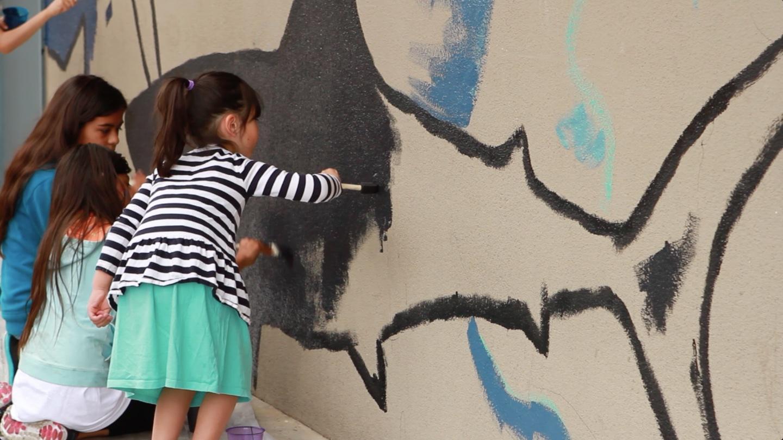 Kids painting the shark mural 2