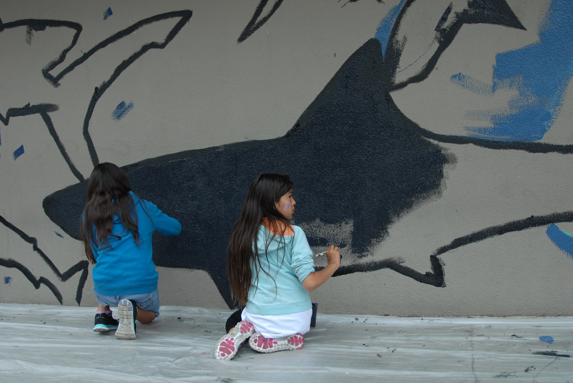 Kids painting the shark mural 5