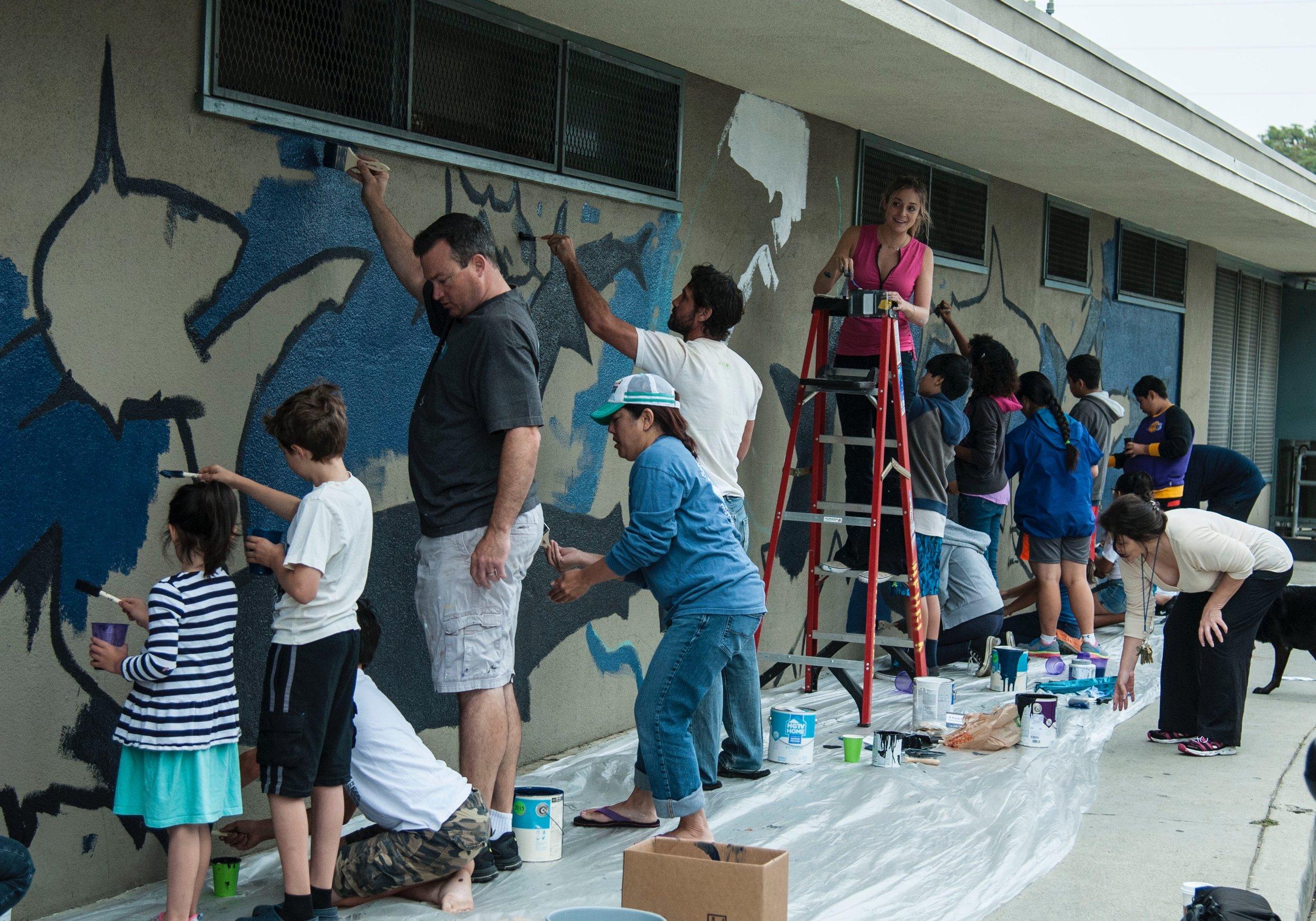 Kids painting the shark mural 7