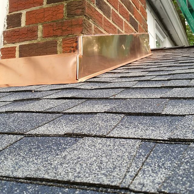 Copper chimney flashing and new roof installed.