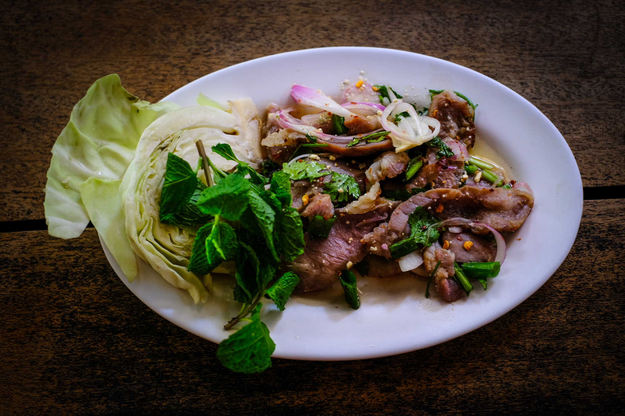 Nam Tok Moo (grilled pork with mint, shallots, and local spices)