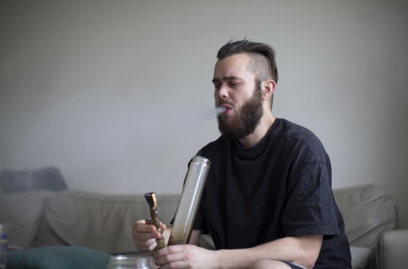 young-man-smoking-drugs-in-bong-at-home.jpg