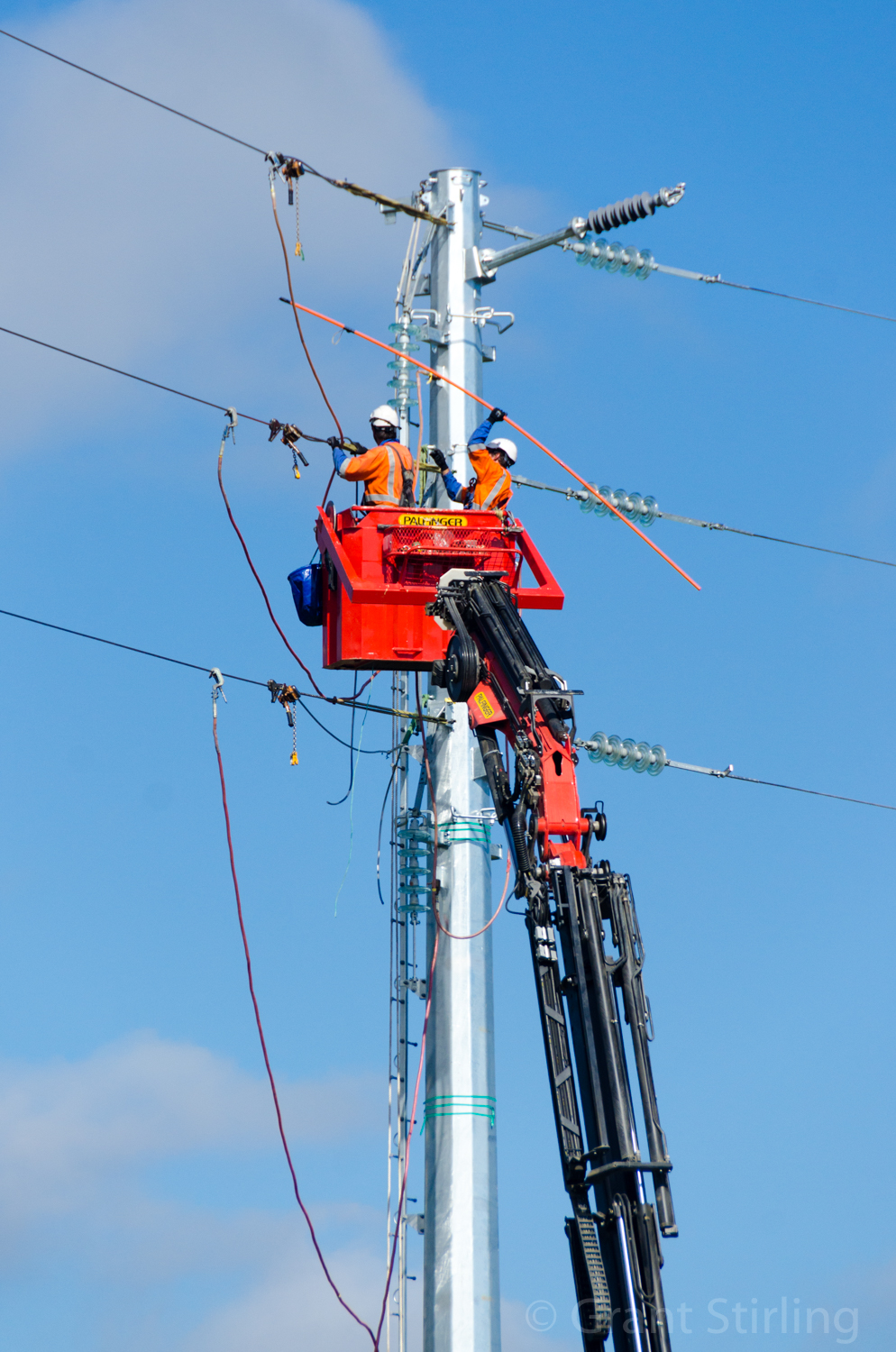 Linesman connecting powerlines