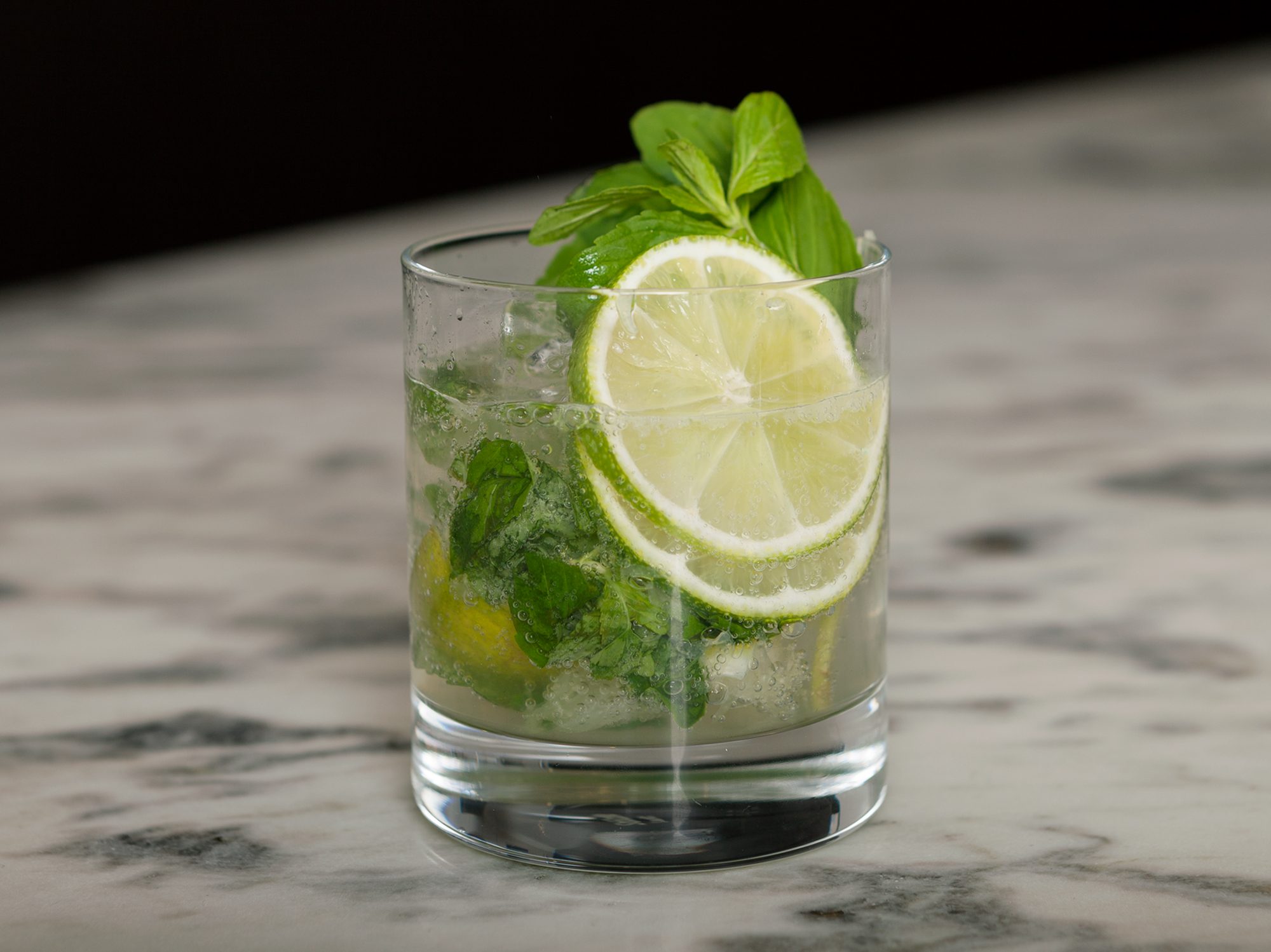 Sake Mojito - 60ml Tōji SakeA handful of Mint leavesHalf a lime, cubed1 tsp SugarSoda waterIceMuddle lime and mint together in your glass.Add 60ml of Tōji Sake and 1 teaspoon of sugar.Fill your glass with ice, stir and top with soda waterGarnish -- 1 mint sprig and two slices of limeEnjoy, Kanpai!