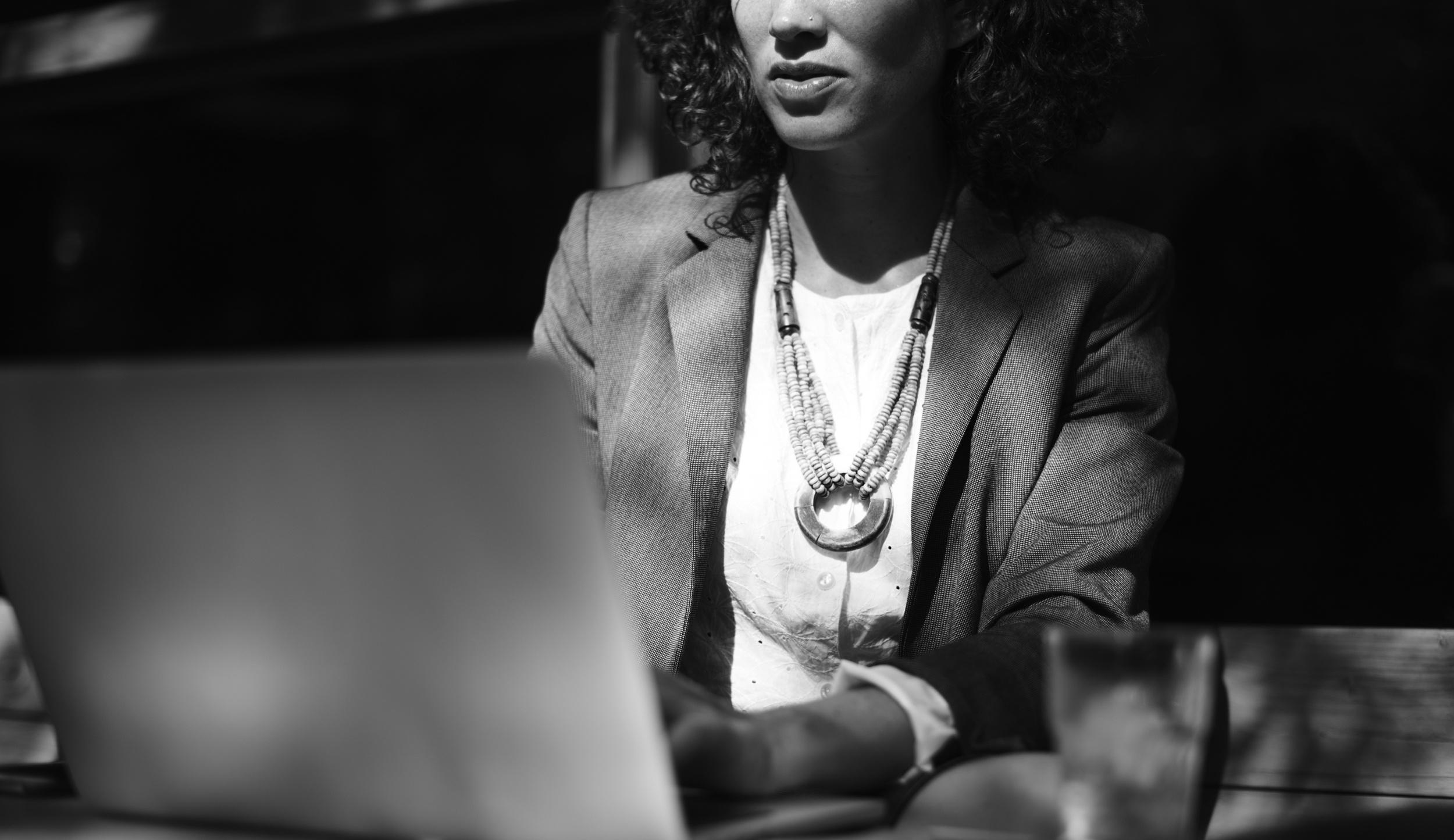 negative-space-black-white-woman-work-laptop-rawpixel (1).jpg