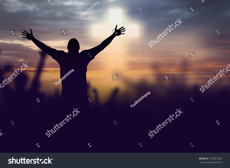 stock-photo-silhouette-of-christian-prayers-raising-hand-while-praying-to-the-jesus-729001495.jpg