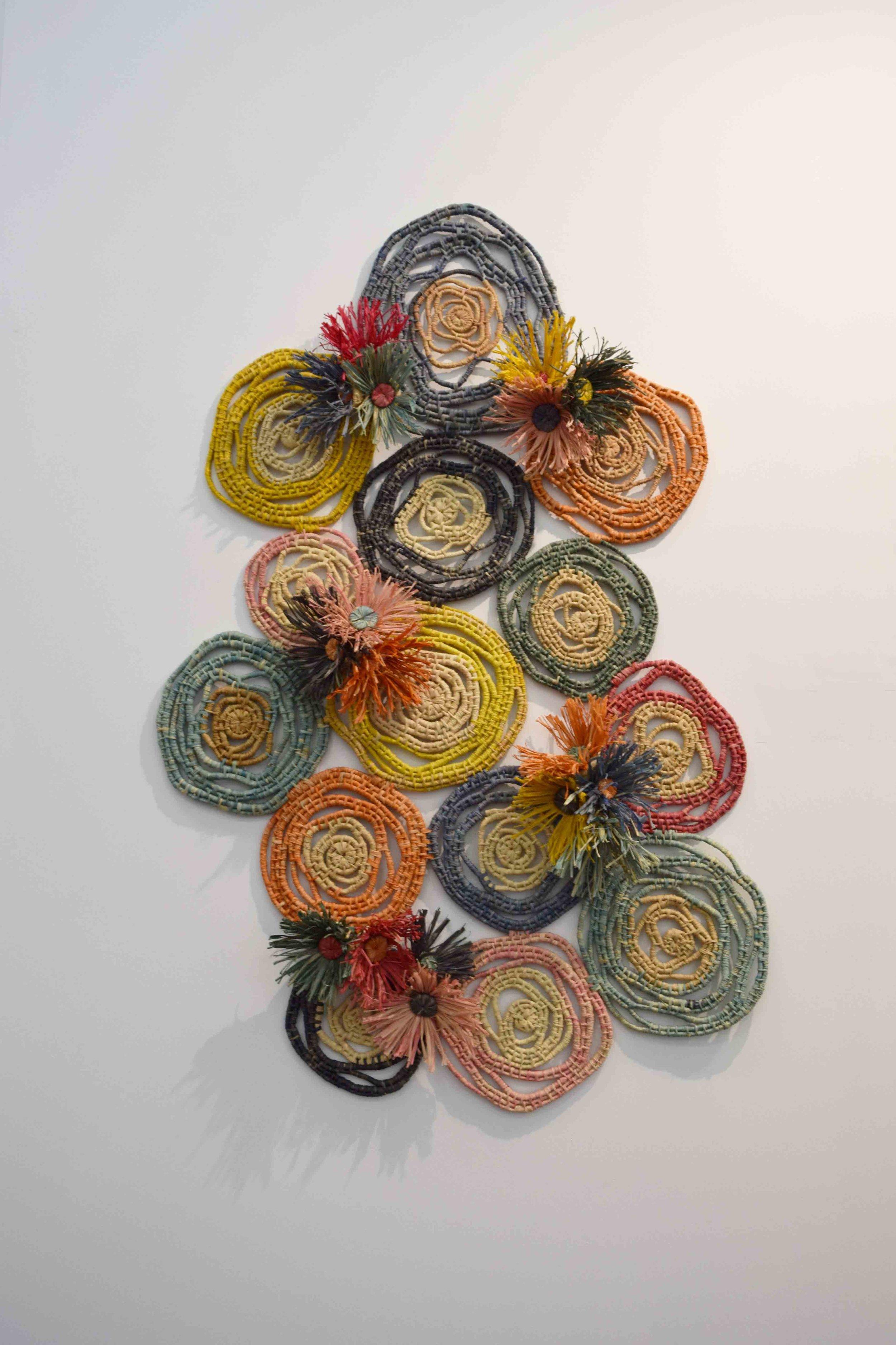 1. Lea Taylor,  Kwobadak Bibbulmun, Moort Danjoo (Beautfiul Bibbulmun Family Together) , 2019, natural, hand dyed raffia, 104 x 68 cm $1,650