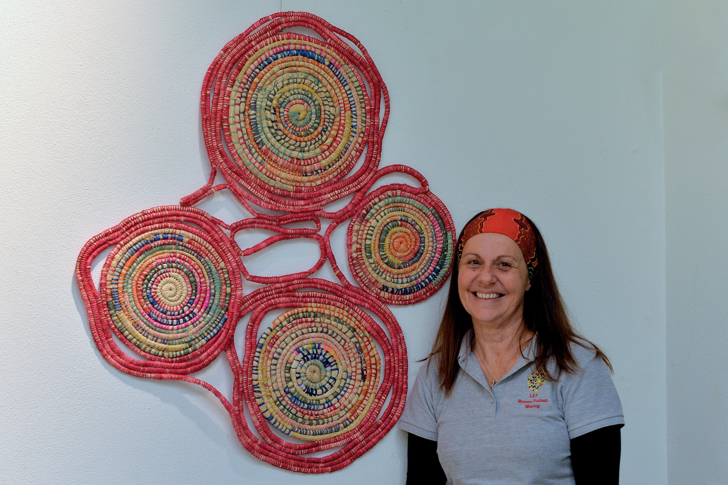 Lea Taylor with her artwork  Walka-Yong A Kaardijin (To Share Knowledge)