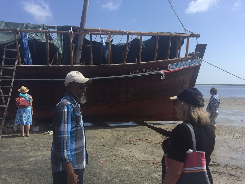 Ali & Jane looking at MV Tunda, and identically sized sailing dhow to the Flipflopi