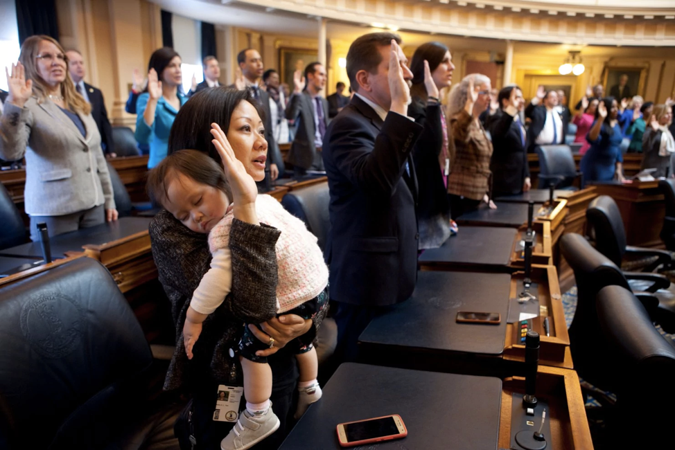 Del. Kathy Tran (D-Fairfax) holds her daughter Elise during her swearing-in ceremony at the Virginia General Assembly on Wednesday morning. Tran is among the 28 women now serving in the chamber, a record high. (Timothy C. Wright for the Washington Post.)