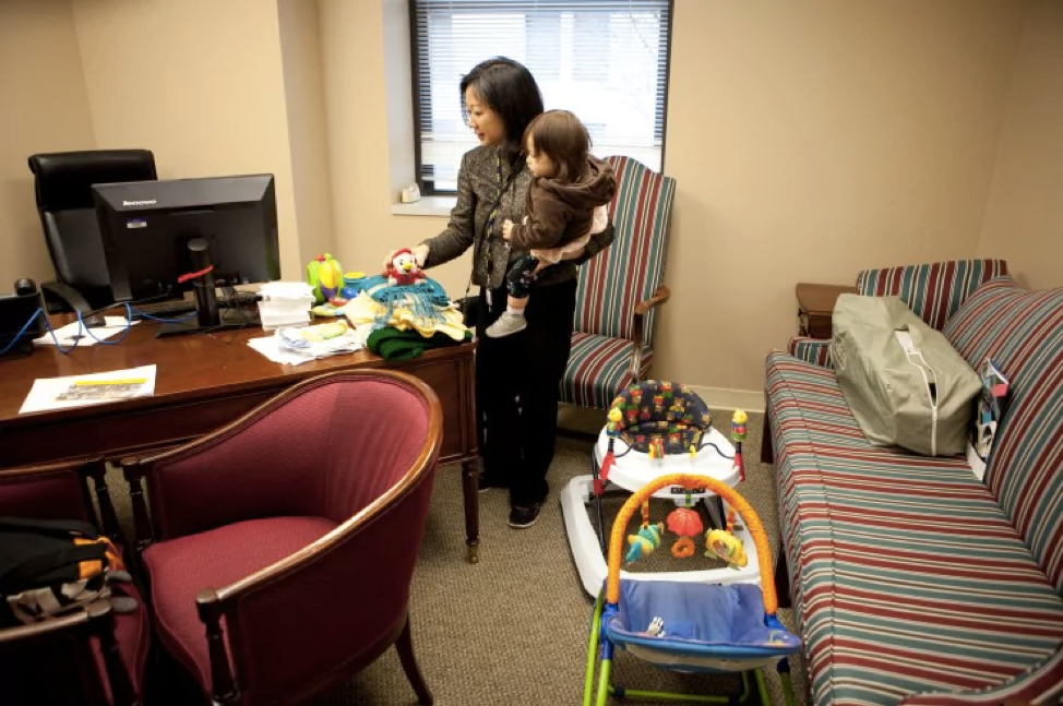 Del. Kathy Tran (D-Fairfax) stands in her new office at the Virginia General Assembly Wednesday morning while holding her daughter Elise. (Timothy C. Wright for the Washington Post)
