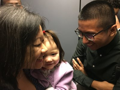 Del. Tran gets help from her staff, including Rodrigo Velazquez, who says he enjoys playing with Tran's baby when the delegate is busy. Photo Credit to Sarah McCammon/NPR
