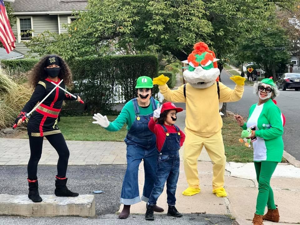 My daughter as a Ninja (her costume wasn't finished), mother-in-law as Luigi, my son as Mario, me as Bowser, and Mom as Yoshi.