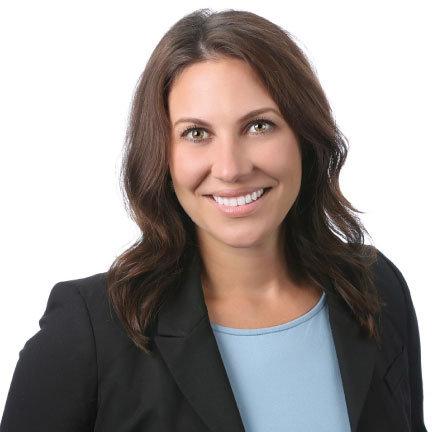 Young professional attorney, female, professional head shot, smiling.