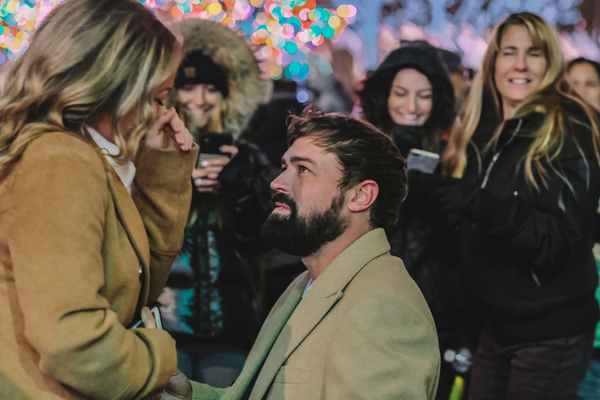 Before Lora even knew she was being proposed to, the crowd was already chanting oh my gosh, he's proposing and cheered along!
