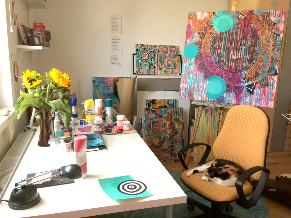 Snapshot of my studio this summer. Sunflowers, Sini the cat and a big painting I was working on.