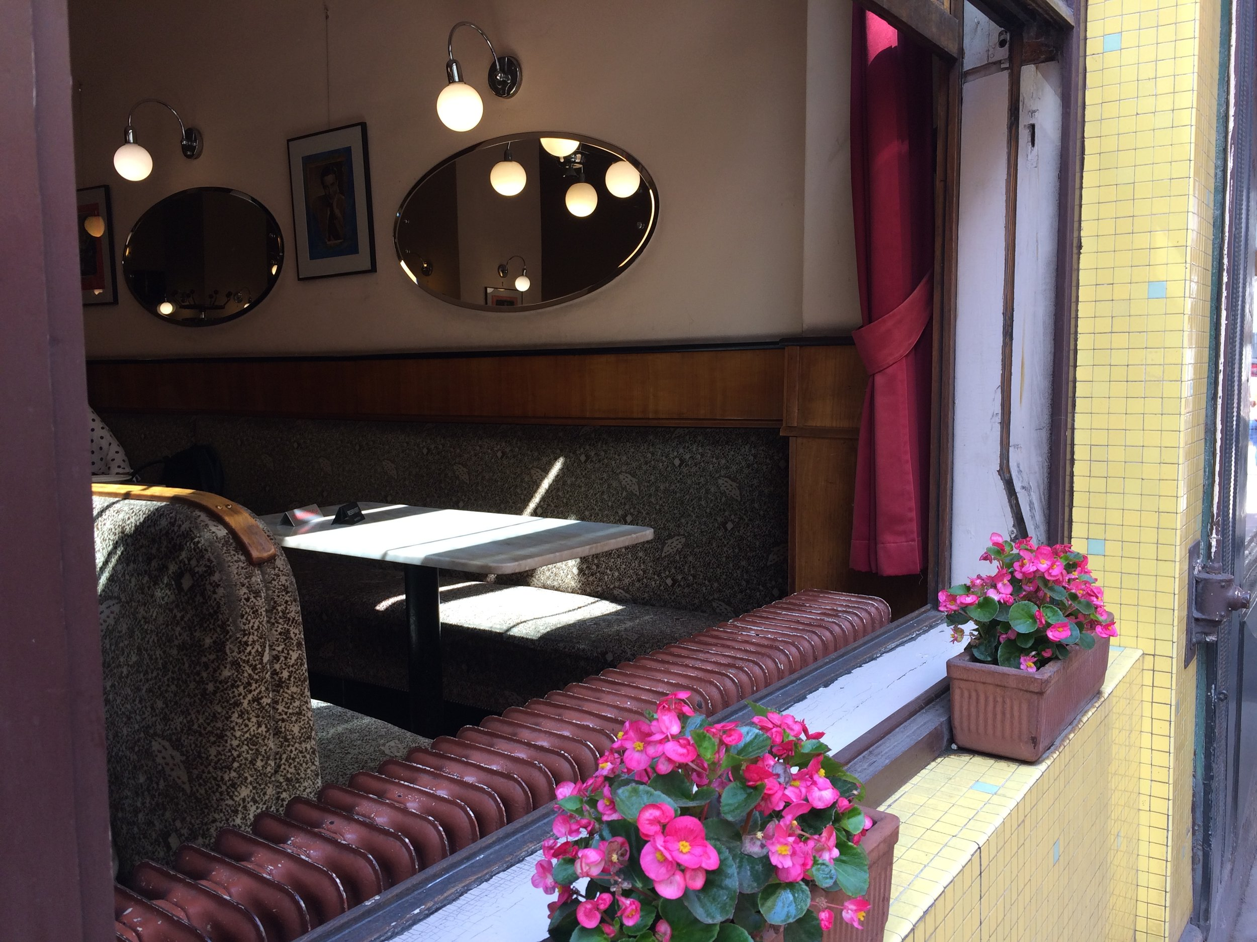 Open windows, how inviting is this coffee house corner?!