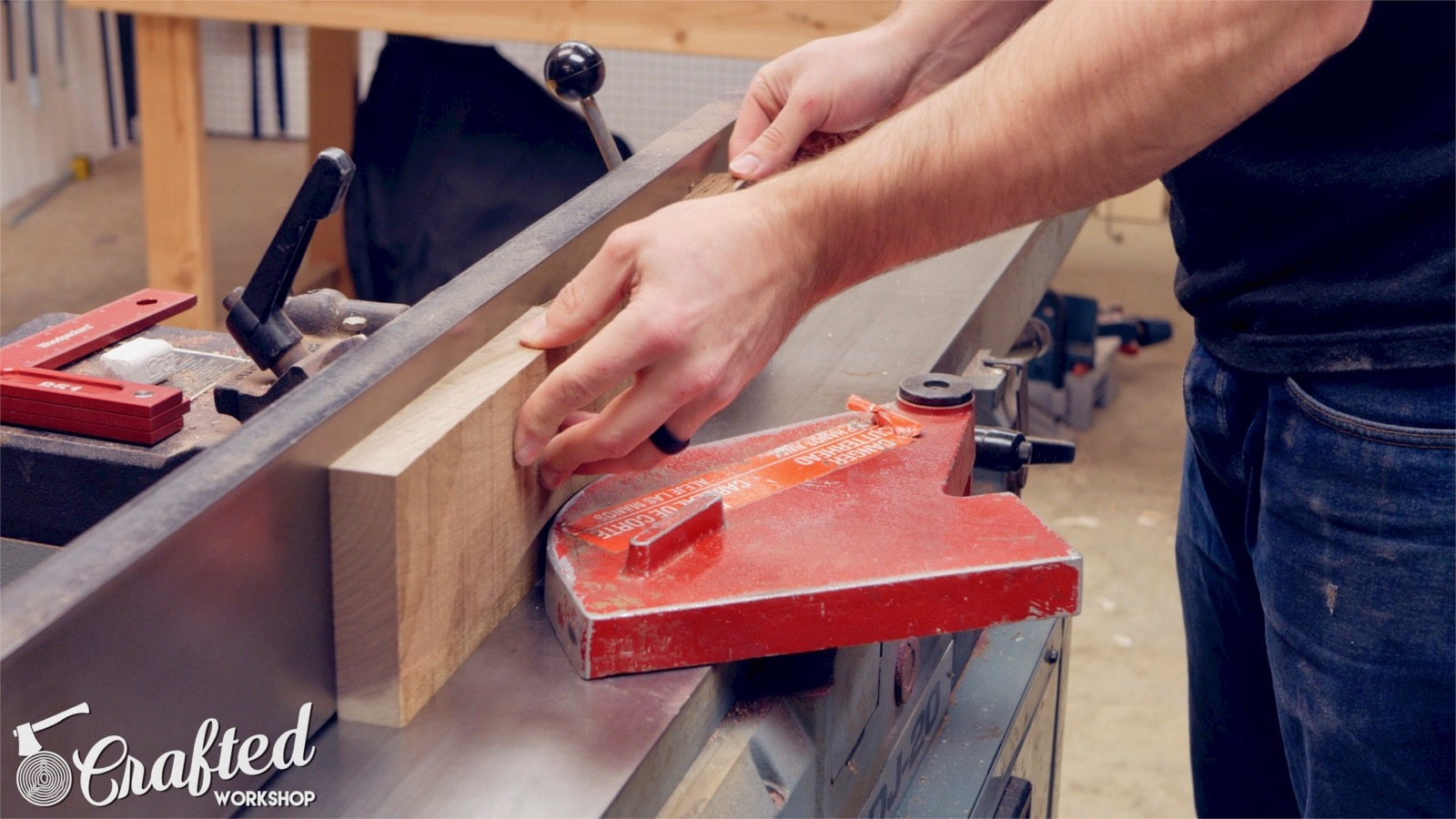 squaring an edge on walnut at the jointer woodworking