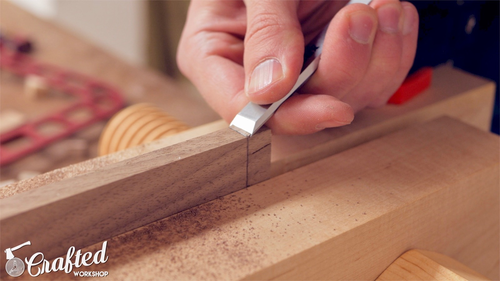 using a chisel to establish a groove for a hand saw woodworking