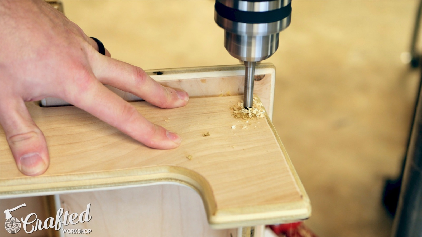 drilling holes into side of plywood for dowels