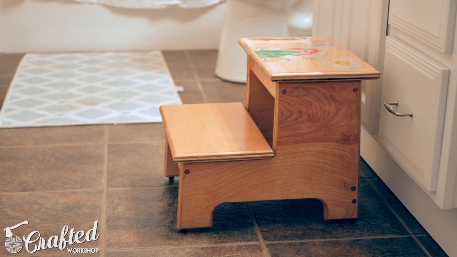 kid's step stool in front of bathroom sink