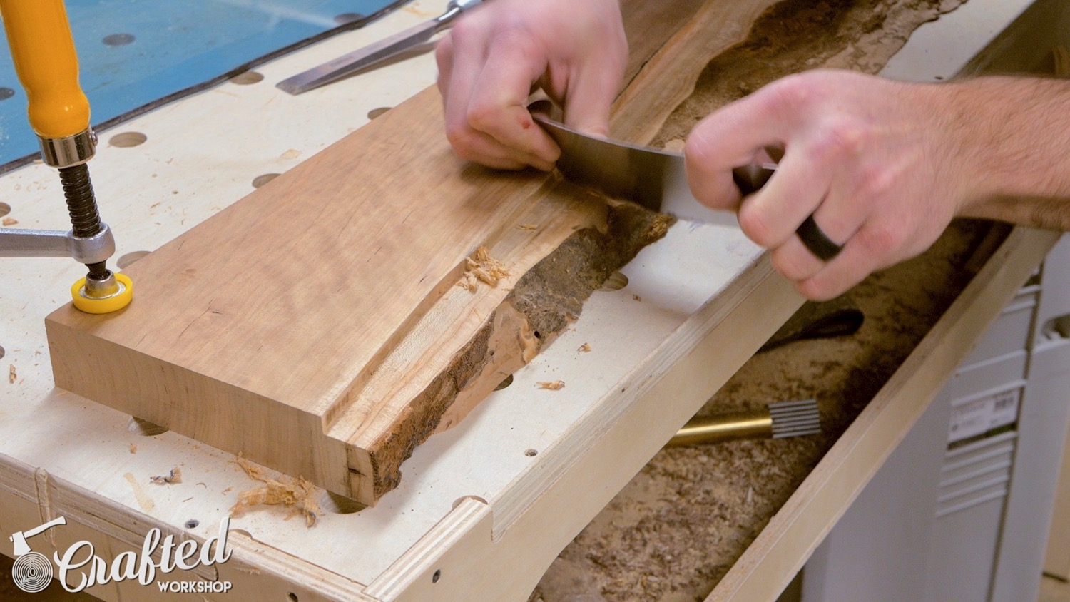 using a card scraper on a live edge slab