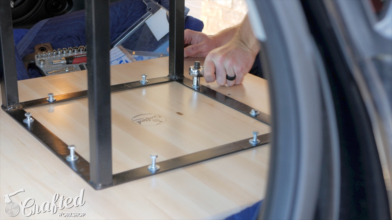 attaching steel table base legs to wood top using threaded holes and bolts