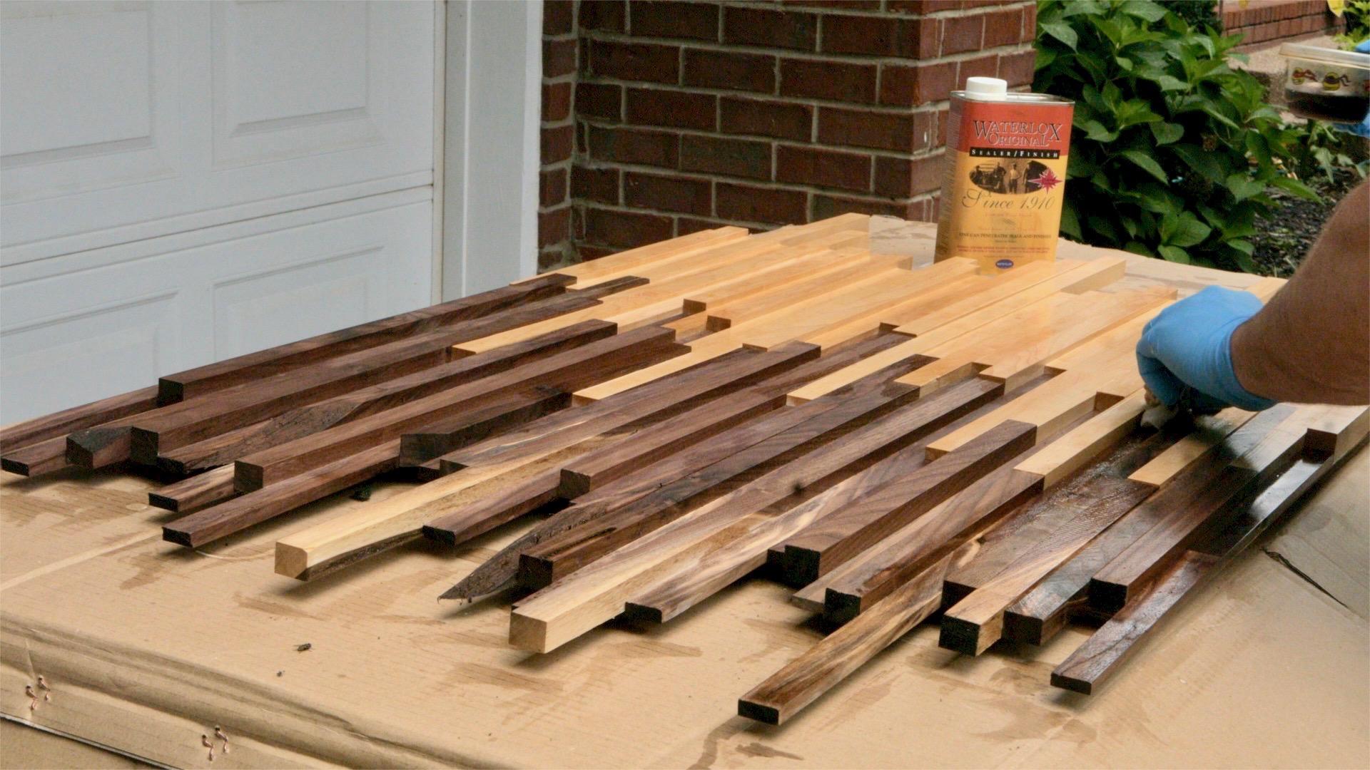 Applying Waterlox to scrap wood wall art.