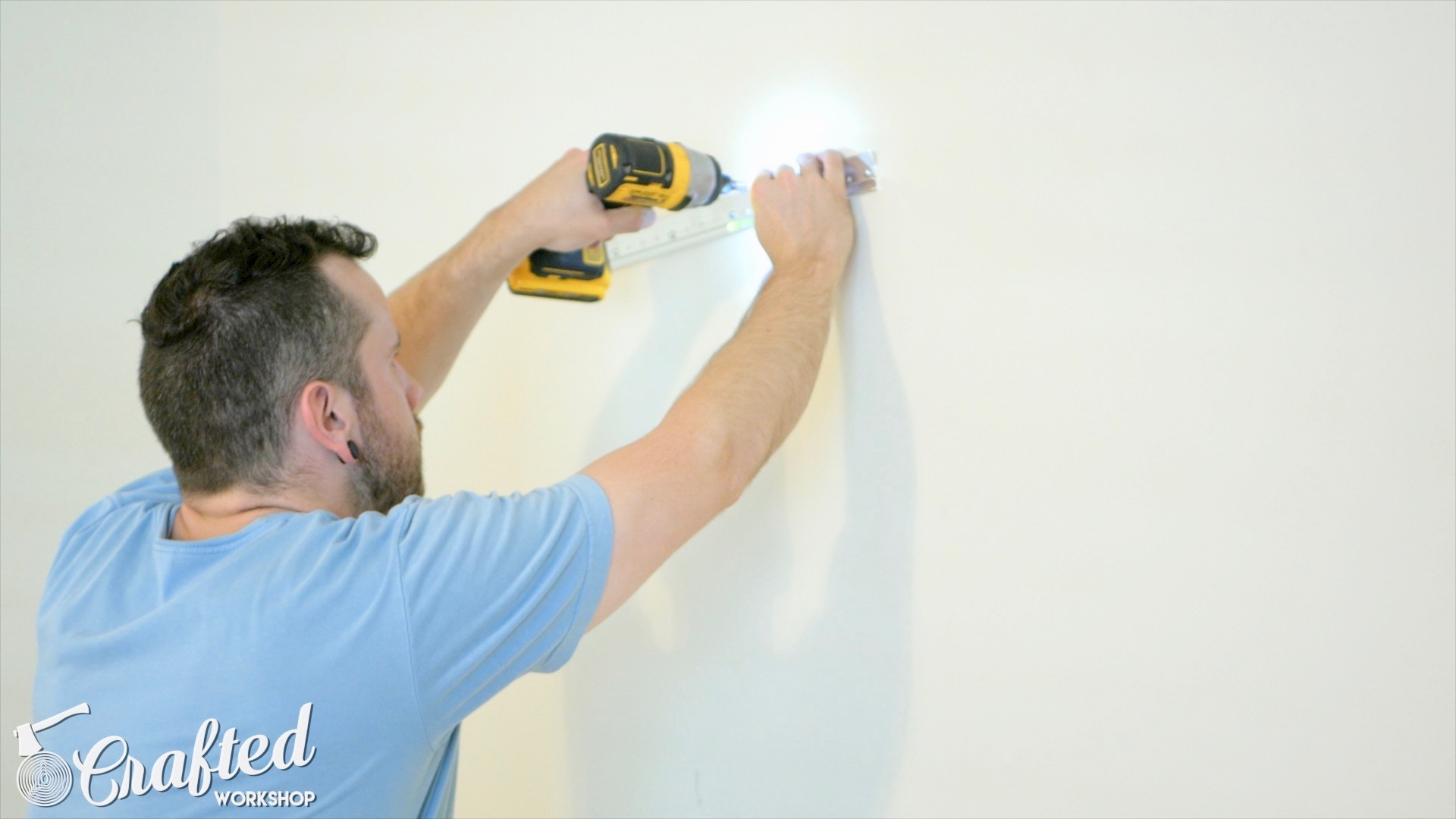 Installing cleat on wall.