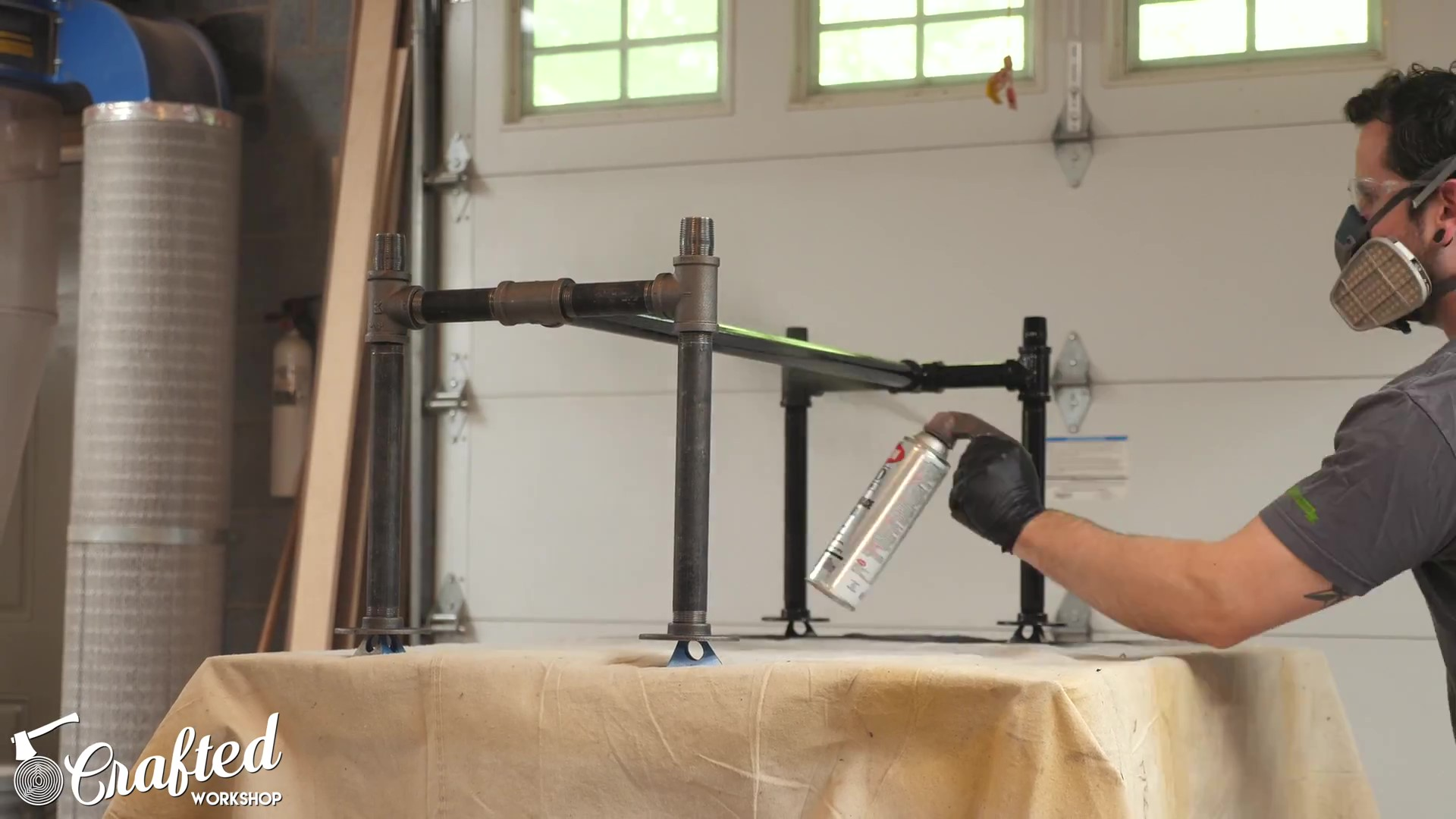 Applying black enamel spray paint