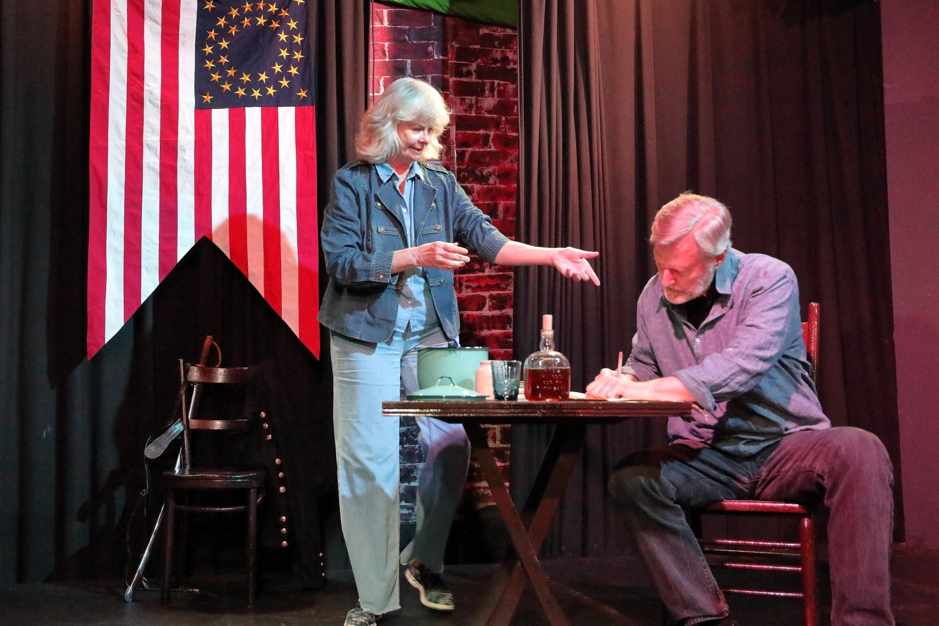 Sherman's Aide (Lynn Lohr) debates the General's plans for Atlanta.